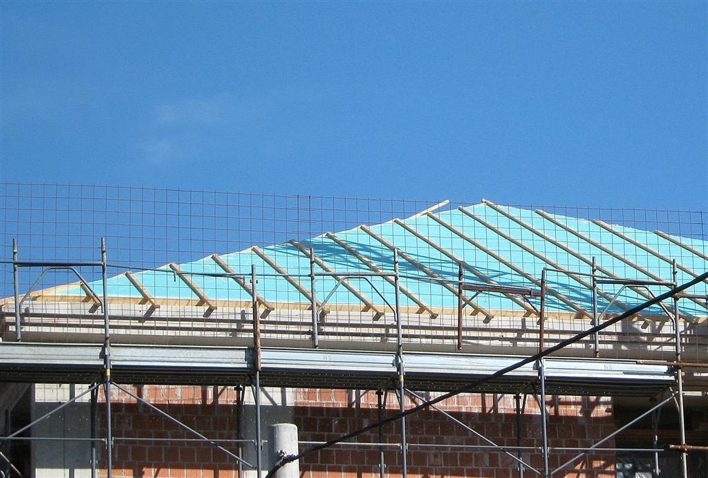 Izolacija poševne strehe